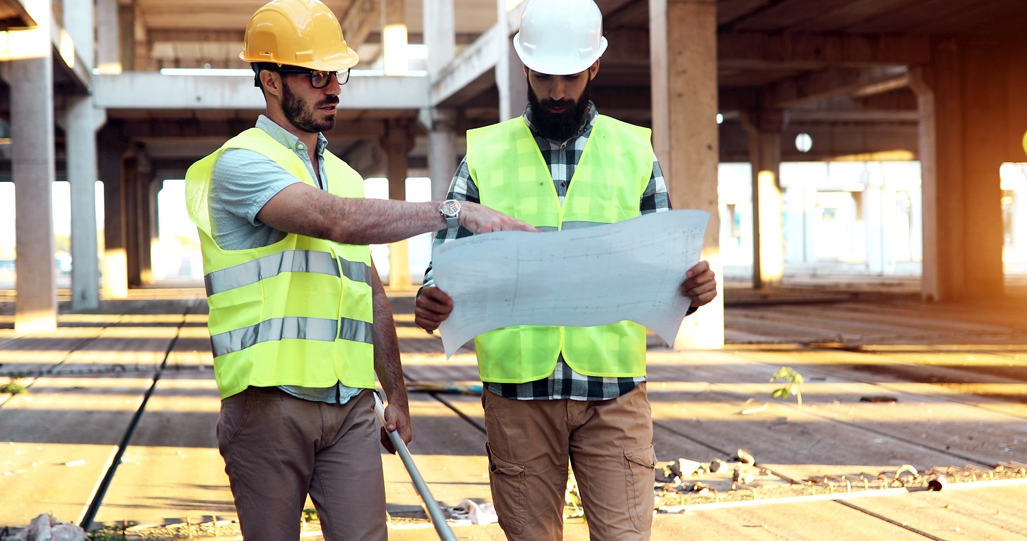 Architect consult engineer on construction or building site